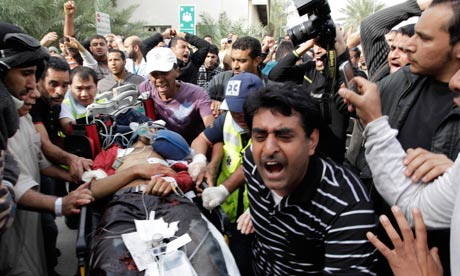 Bahraini demonstrator lies injured on a stretcher