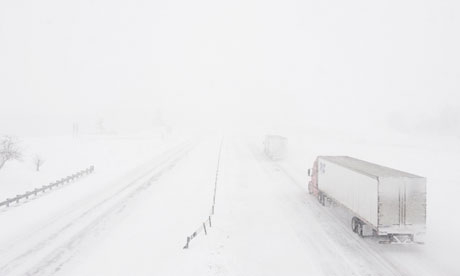 Lorries struggle through whiteout conditions on the I-70 highway in Missouri