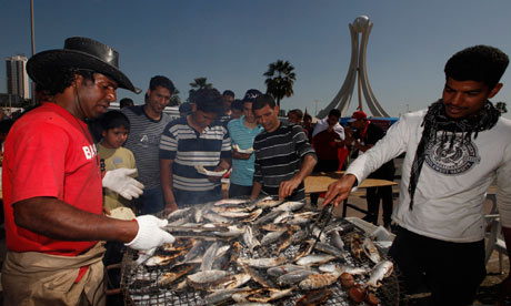 Protesters have barbecued fish for lunch in Pearl Square in Manama, Bahrain