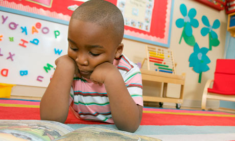 Preschool boy reading