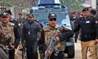 Pakistani police escort Raymond Davis to a hearing
