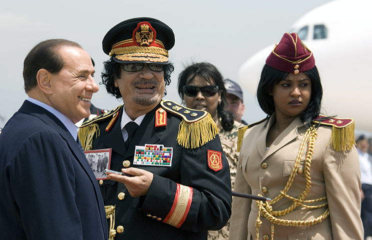 Muammar Gaddafi : June 2009: Gaddafi and Italy's PM Berlusconi leave Ciampino Airport in Rome