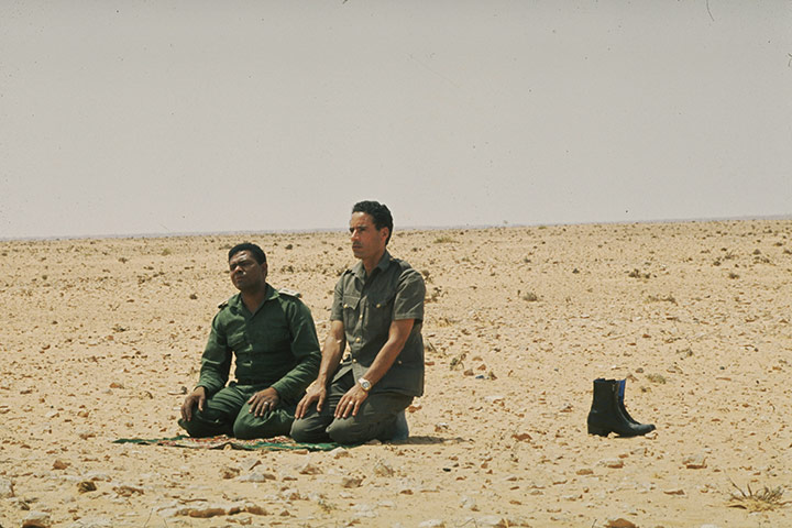 Muammar Gaddafi : August 1973: praying in the desert near Surt