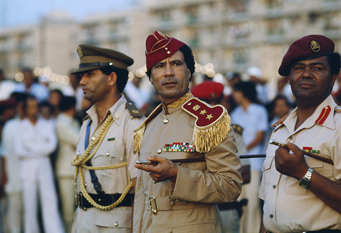 Muammar Gaddafi : Gaddafi at women's military academy graduation in 1981