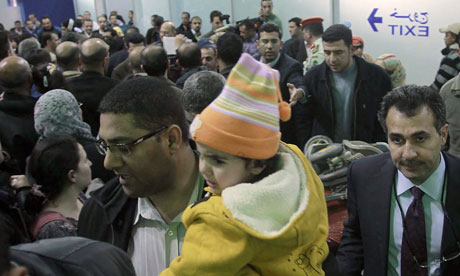 Jordanian families arrive in Amman from Libya on 21 February 2011