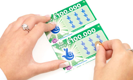 Woman scratching Scratchcard