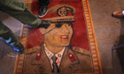 libya update 2: Libyans step on a carpet featuring Libyan leader Gaddafi in Benghazi