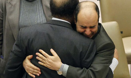 Abdurrahman Mohamed Shalgham is hugged by his deputy Ibrahim Dabbashi