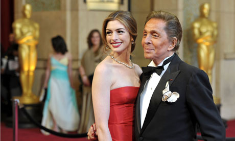 Actress Anne Hathaway and fashion designer Valentino arrive at the Oscars