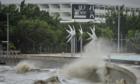 Cyclone Yasi High winds and rain push a swell onto a promenade in Cairns in