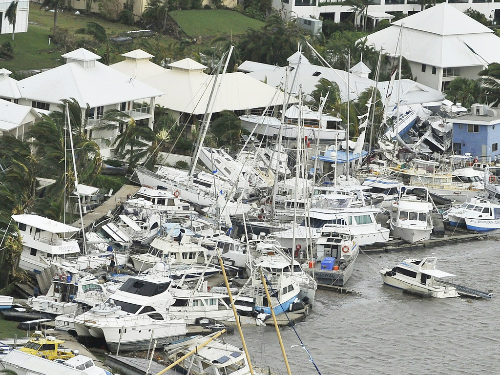 Yachts lie badly damaged in Cardwell after cyclone Yasi hits