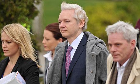 Julian Assange arrives at court