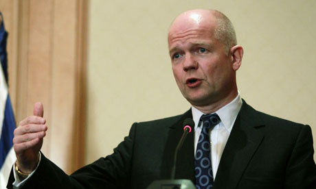 William Hague addresses the media during a news conference in Tunis