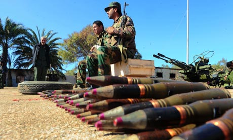 Libyan soldiers who have defected against Moammar Gaddafi guard anti-aircraft guns