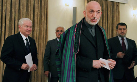 The Afghan president, Hamid Karzai, pictured during a recent visit by the US defence secretary, Robert Gates (left), has been ratcheting up his criticism of Nato-led troops for killing civilians. Photograp