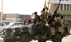 Libyan rebels patrol the eastern coastal