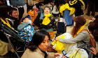Child reacts to earthquake aftershock in Tokyo