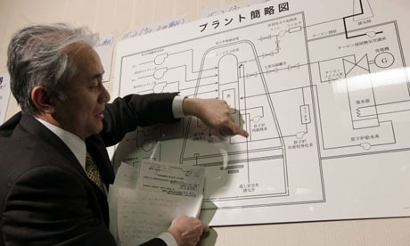 Japan Nuclear crisis: A Tokyo Electric Power official points at an illustration of a nuclear plant
