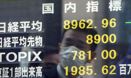 Japan nuclear crisis: a businessman is reflected on a share price board