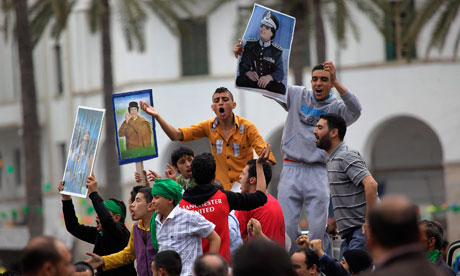 Gaddafi supporters celebrate in Green Square in Tripoli 