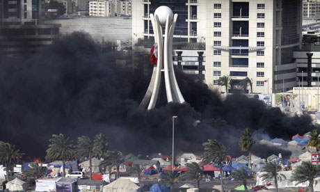 Black smoke billows from burning tents in Pearl Square, Bahrain