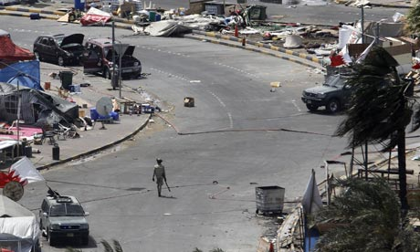 A GCC soldier walks through Pearl Square, Bahrain, after securing the area from protesters