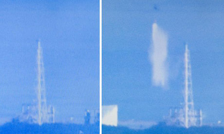 A helicopter drops sea water on Fukushima. Photograph