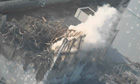 Handout shows steam rising from the No. 3 reactor at the Fukushima Daiichi nuclear power complex