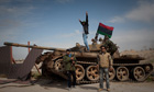 Libyan rebels with a government tank