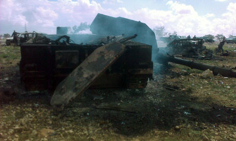Debris of wrecked military vehicles destroyed in air strikes by the coalition west of Benghazi Libya