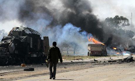 Gaddafi's forces suffer coalition attacks