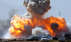 Gaddafi's forces are hit by coalition air strikes