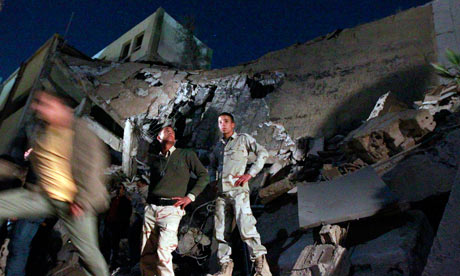 Libyan soldiers survey the damage to an administrative building in Gaddafi's Tripoli compound.