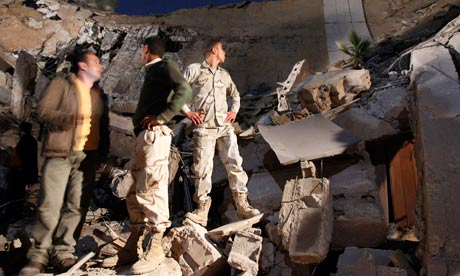 Libyan soldiers survey the damage to Moammar Gadhafi's Bab al-Azizia compound in Tripoli, Libya