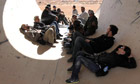Photojournalists, including New York Times photographers Tyler Hicks and Lynsey Addario in Libya