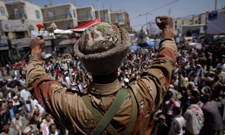 A Yemeni army defector joins protesters demanding the resignation of President Ali Abdullah Saleh