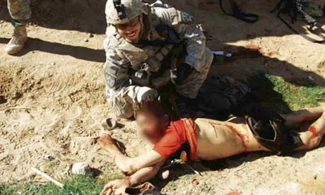 Photos show US soldiers in Afghanistan posing with dead civilians ...