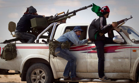 Libyan rebels retreat as mortars are fired on them on the frontline of Ajdabiya