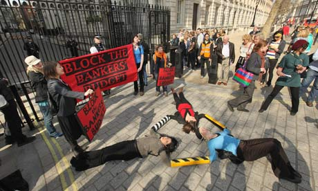 Protesters block the entrance to Downing Street in advance of the budget