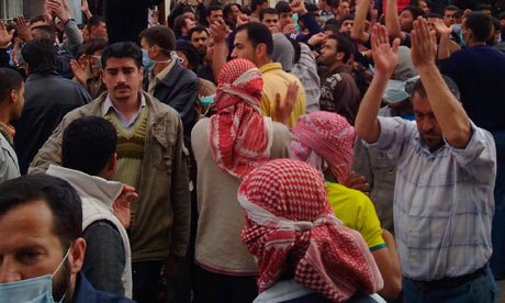 Protesters gather near the Omari Mosque in the southern old city of Deraa