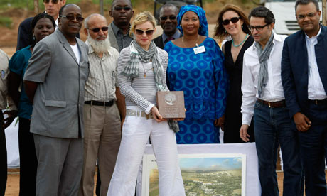 Madonna laying the first stone of Raising Malawi Girls Academy