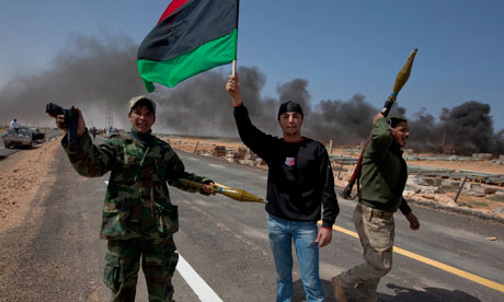 Libyan rebels celebrating west of Ras Lanuf