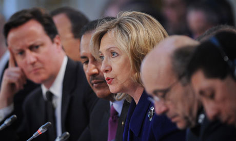 Hillary Clinton speaks as David Cameron listens during the London Conference on Libya