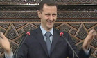 Video grab of Syrian president Bashar al-Assad acknowledging applause before addressing parliament
