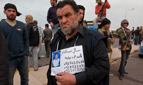 Libyan father Mohammed Ahmed Boulika looks for his son, Ahmed Mohammed, in Ras Lanuf