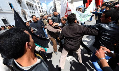 Pro-Kadhafi and anti-Kadhafi protesters clash during a demonstration