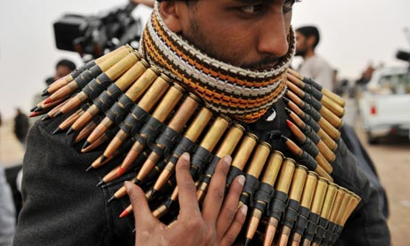 http://static.guim.co.uk/sys-images/Guardian/Pix/pictures/2011/3/4/1299266321226/A-Libyan-rebel-fighter-wr-007.jpg