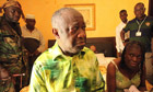 Ivory Coast strongman Laurent Gbagbo and his wife Simone sit on a bed at the Hotel du Golf