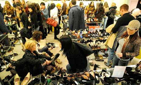 Shoppers look at shoes in Selfridges