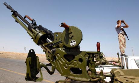 A rebel fighter looks through binoculars, Ajdabiyah 14 April 2011